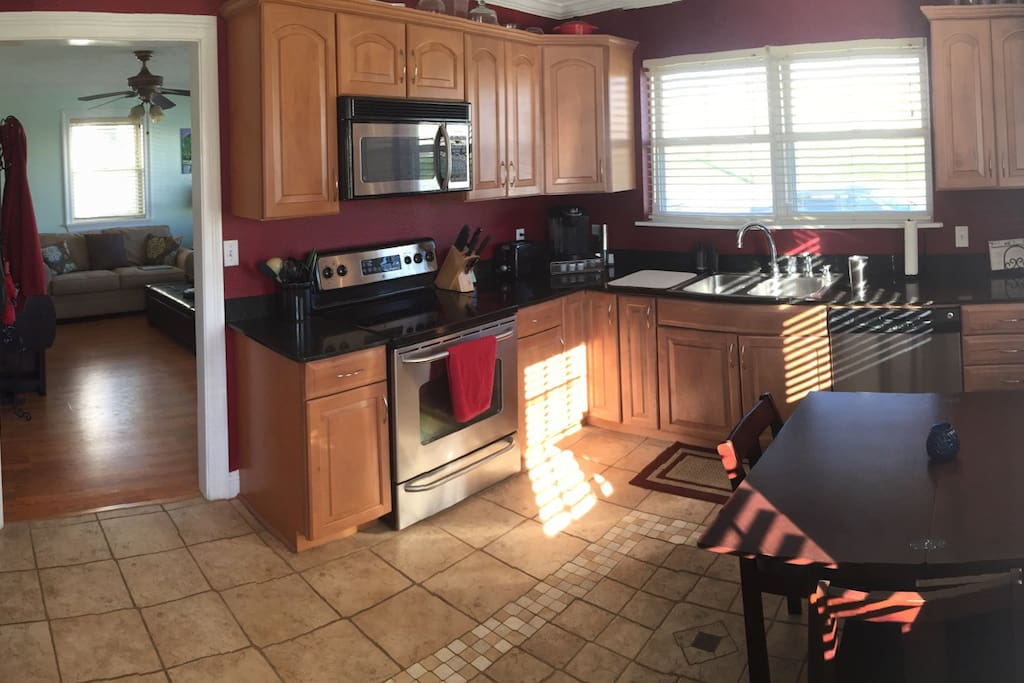 Fully stocked kitchen with table seating up to 4.