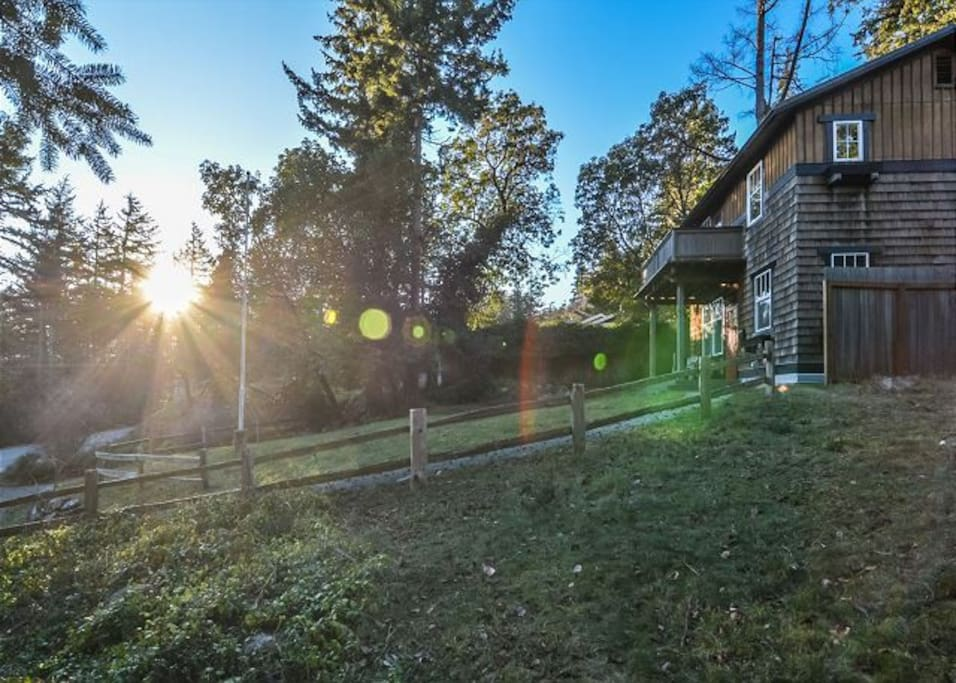 This cedar shakehome is perched on a hillside less than a half mile away from the sleepy village of Eastsound.