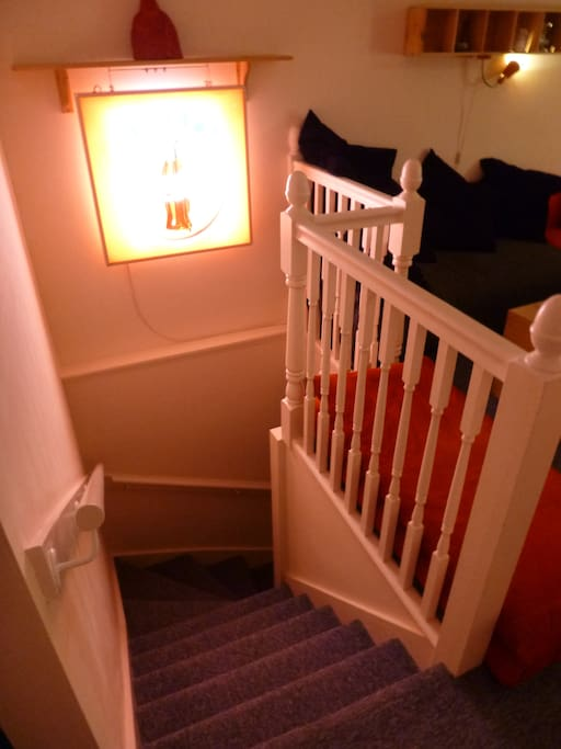 Stairs lead to basement bedroom & bathroom