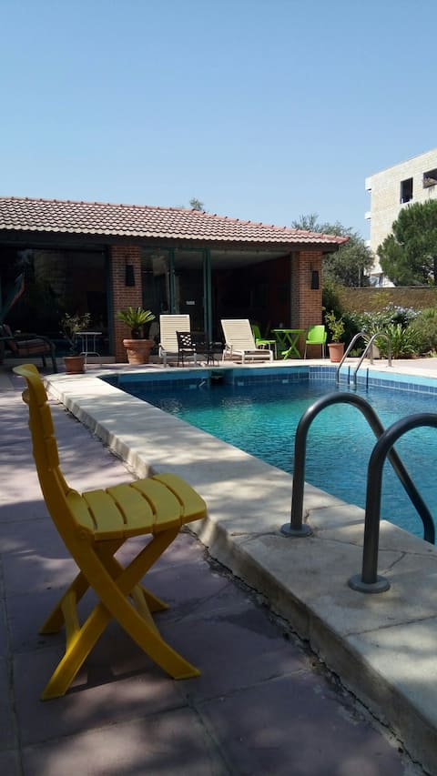 a beautiful located 50 meter pool house.