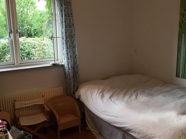 Double bed (120x200 cm) in second bedroom.