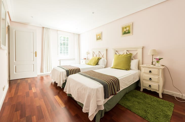 Twin bedroom in a luxury villa near Madrid