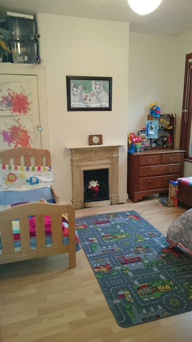 Child's room with two single beds.