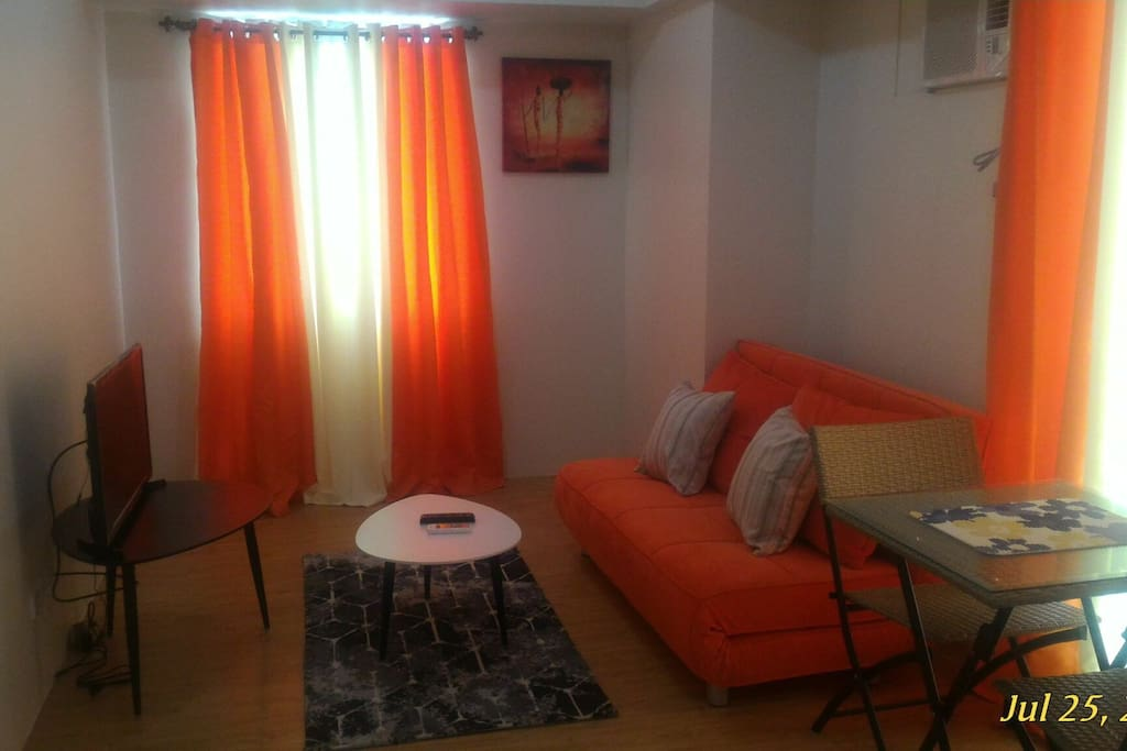 Sala space with sofa bed led tv
