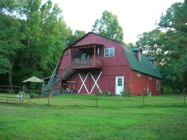 lower pasture with fire ring close to cook shack and indoor bathroom.