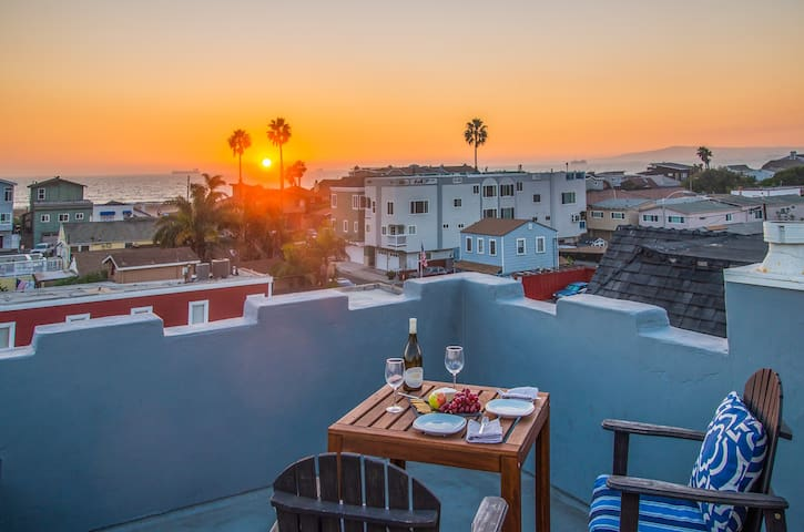 Roof top deck with breathtaking sunset and ocean views.