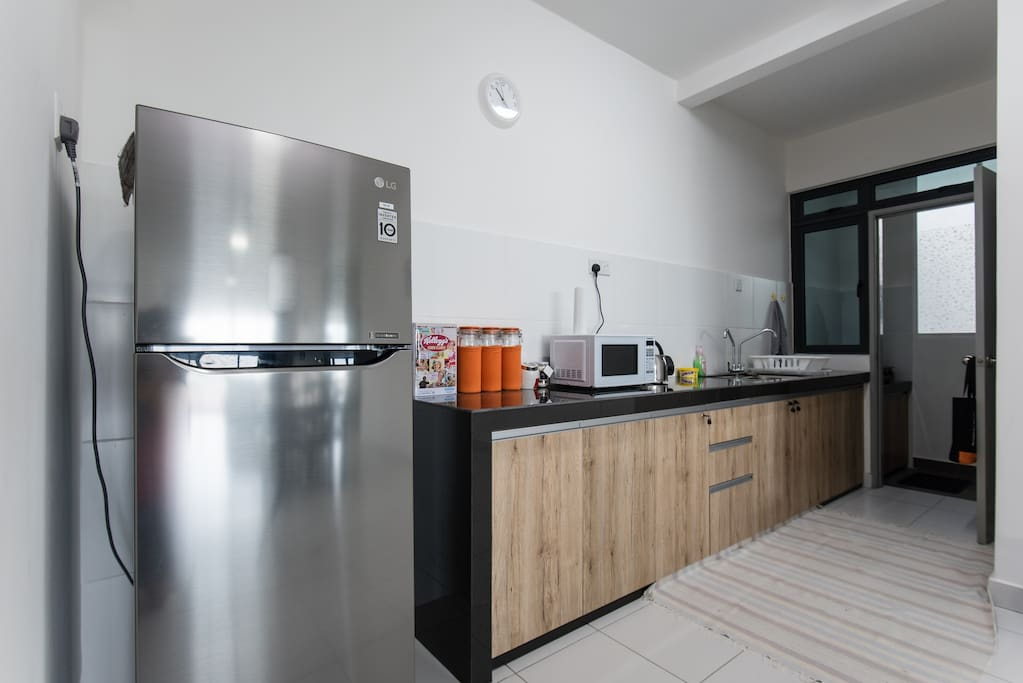 Kitchen with fridge, electric kettle, microwave oven & gas cooker