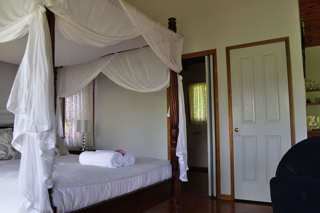 Cottage number 3 - the bathroom with spa is located near the bed. We are located in Mapleton, on the Sunshine Coast Hinterland, which is part of the Blackall Range and close to the interesting towns of Montville, Maleny, Eumundi, Yandina, Kenilworth,  Noosa and the Glass House Mountains.