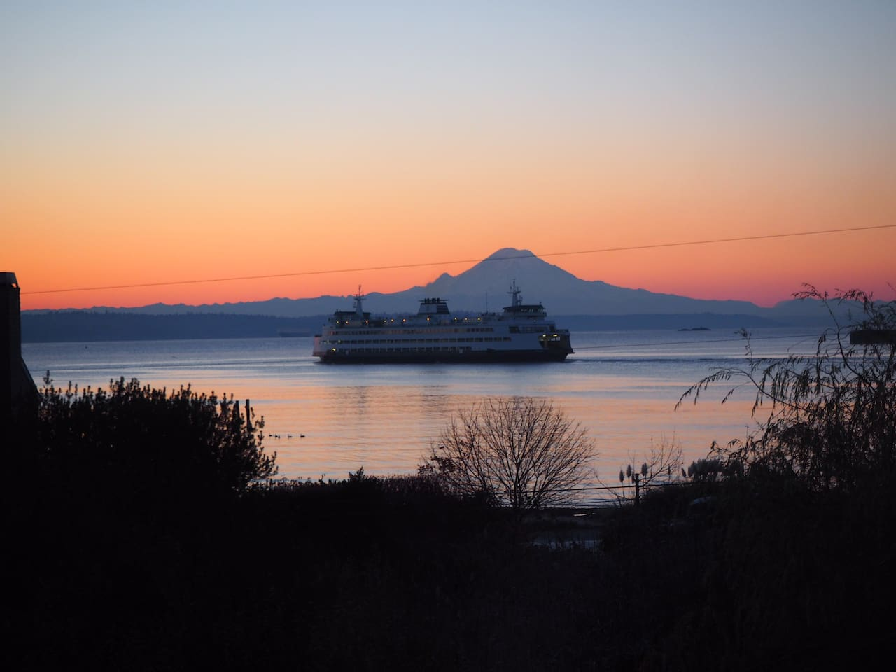 Bainbridge Island - arrive by ferry. Great views of Mt Rainier from many places