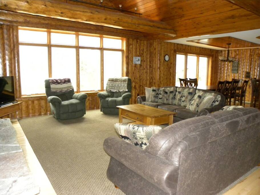 Large great room area with wood burning fireplace.