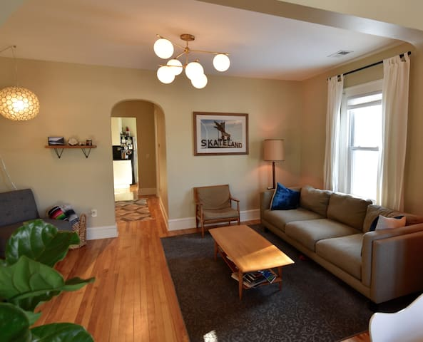 Living room with extra long comfy couch and TV with Netflix, Amazon Prime, and Hulu.