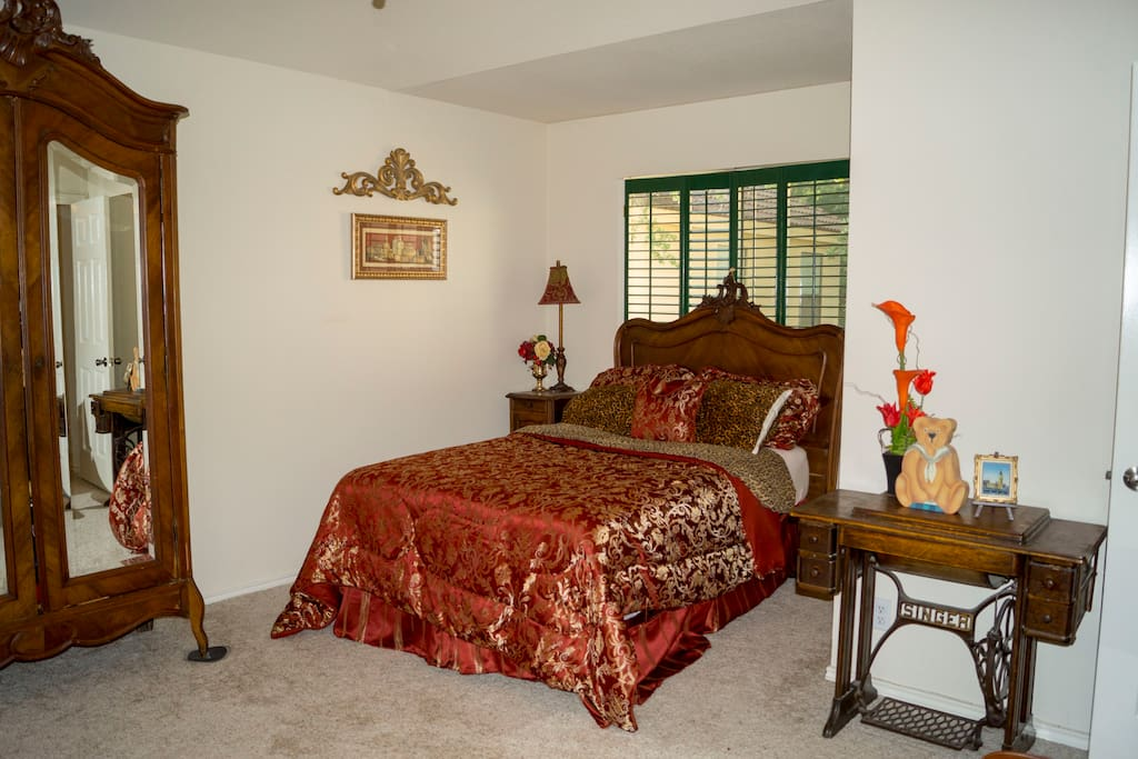 Spacious bedroom with niche for cozy bed, sitting area and enormous double walk in closets