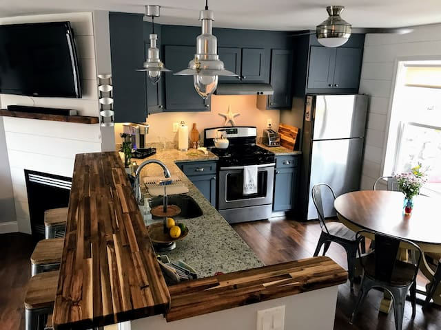 Fully stocked modern kitchen, with all the amenities.