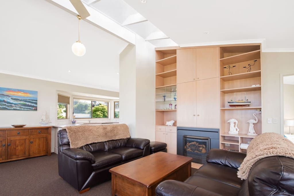 High ceilings and quality furniture make this lounge room a delight