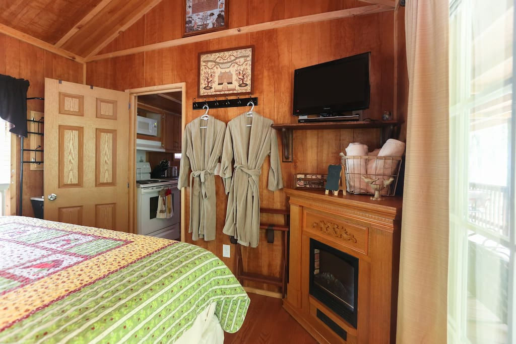 Comfy robes and fireplace in bedroom