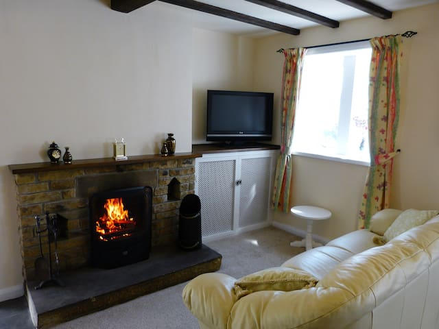 The cosy sitting room with real log fire