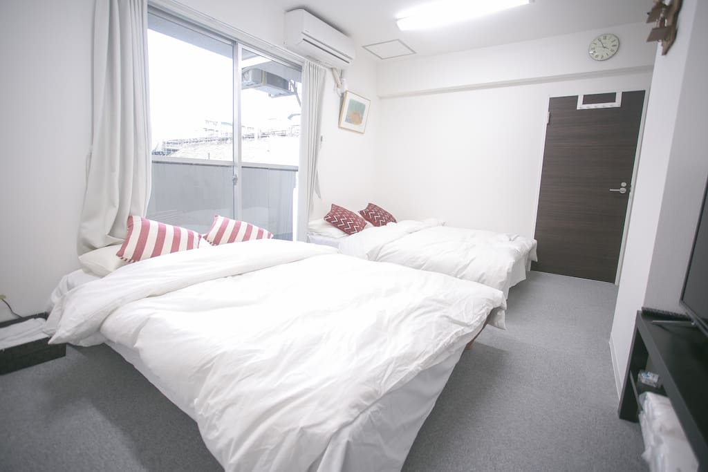 bedroom 1 with 2 double sized beds
