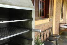 Churrasqueira de concreto na varanda