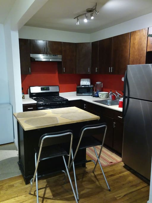 Kitchen with available appliances, utensil.
