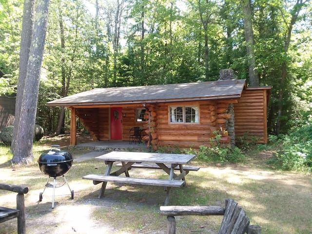 This cabin  will take you back in time.  Built circa 1927-1933 this gem is nestled in the woods with 8 other log cabins.    * The cabin is rustic. If you're looking  looking to be in the woods and spend time in nature this is the spot for you.