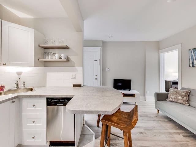 Open-concept living, dining and workspace.