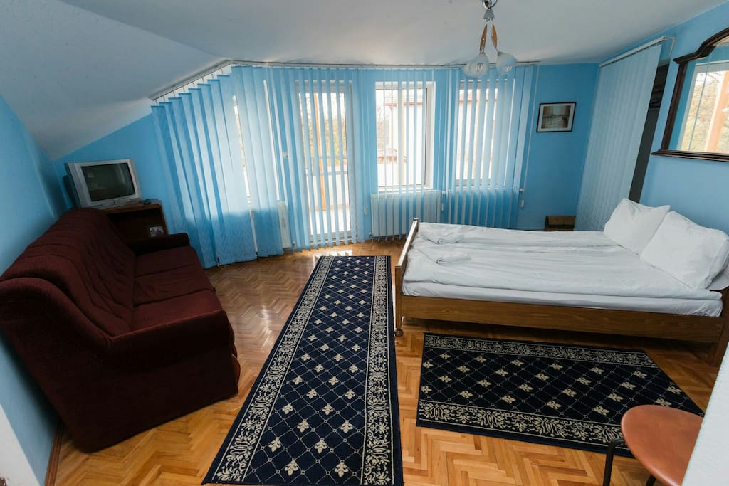 The room no 4 is painted in a beautiful blue colour.  It has one large bed and one sofa. It's perfect for family with children, or for a nice couple. The room has private bathroom, a large balcony, TV, tv cable, free WiFi.