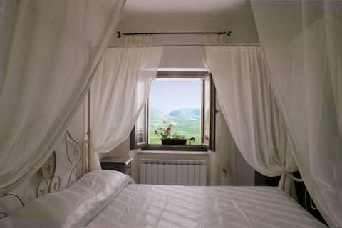 White room in Castelluccio with Piangrande view
