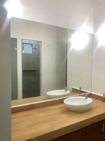 Espejo Frente a baños