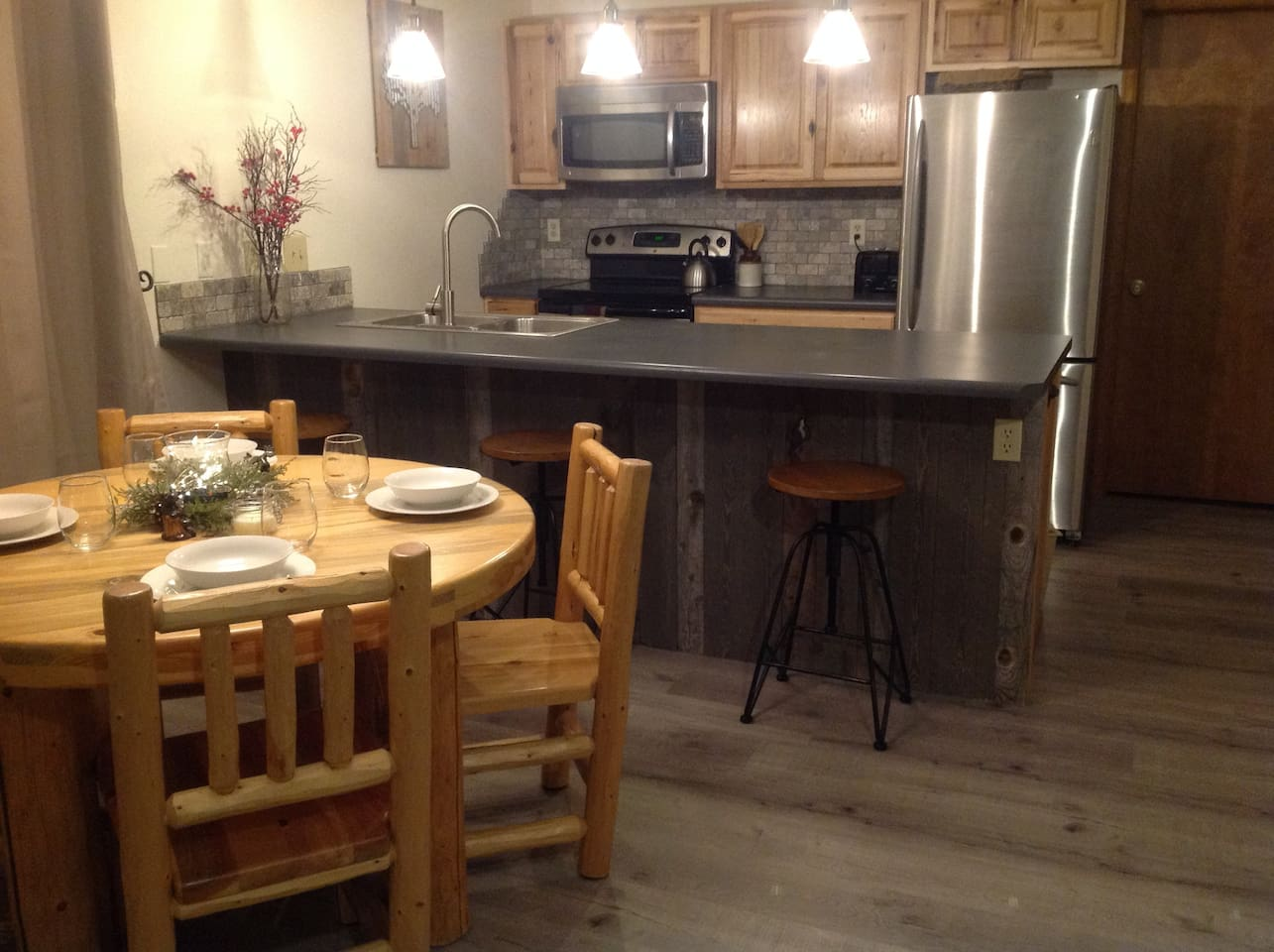 Remodeled kitchen with extra large countertop bar