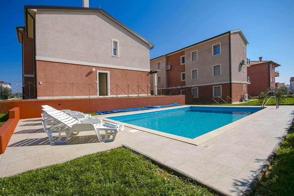 Swimming pool and ap.building