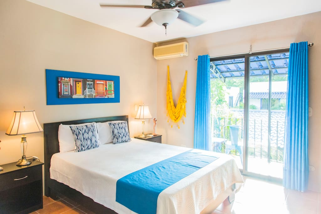 Master bedroom with private balcony facing pool