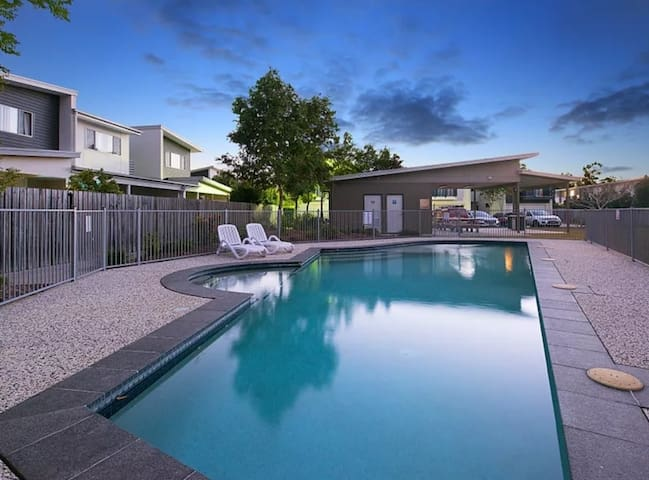 2 rooms in our townhouse. Pools, outdoor bbq areas