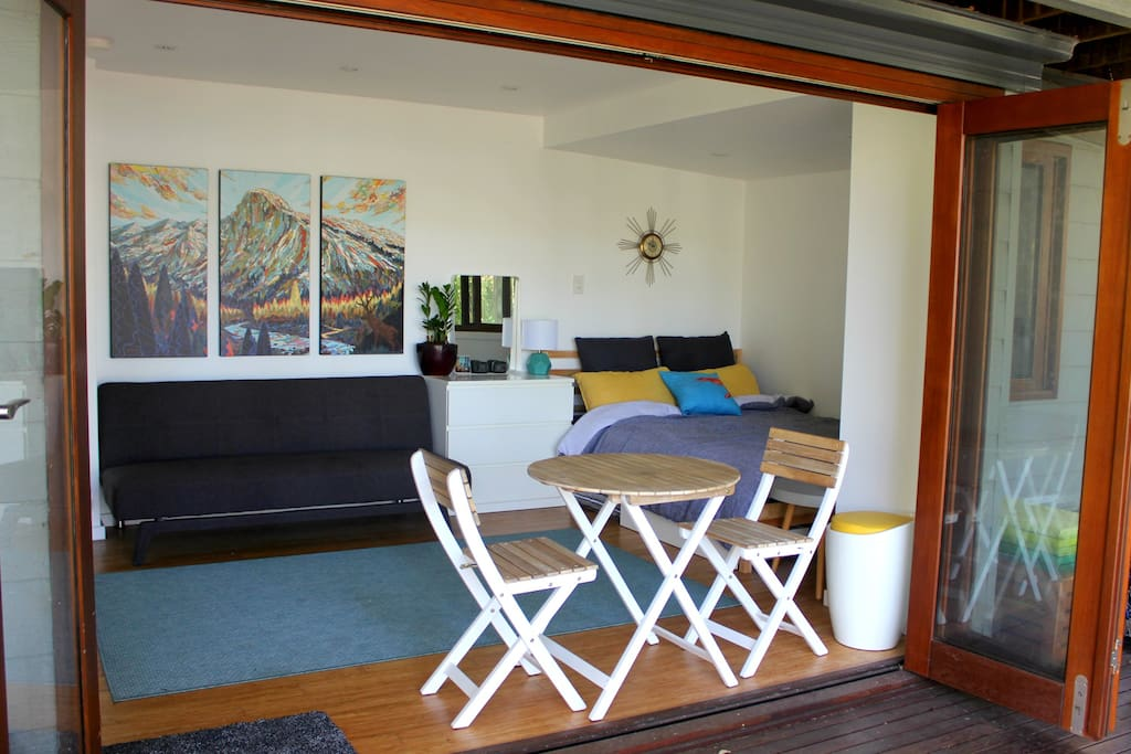 Your room opens up onto a large, leafy, private deck and is detached from the main house.
