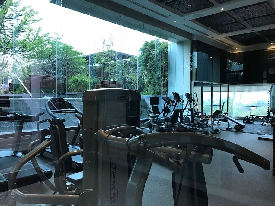 Gym with shower facilities and pool on same level.