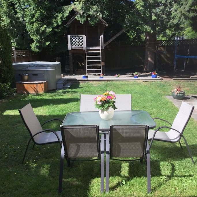 Shared back yard with new barbecue hot tub and trampoline