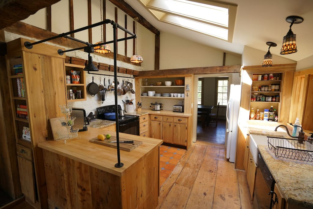 Sun-filled country kitchen with plenty of pots, pans, and spices to get you cooking.