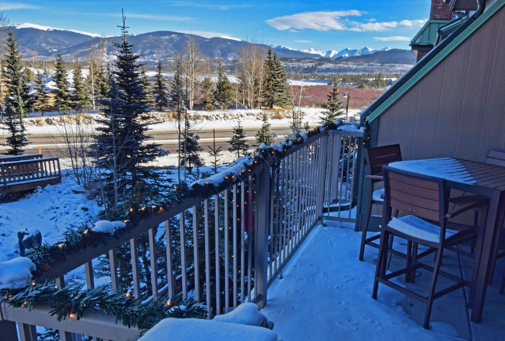 The balcony deck with snow  on it.