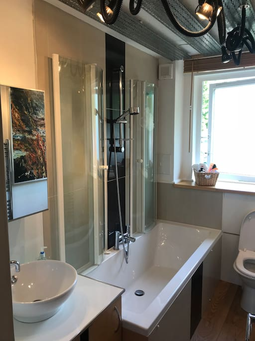 Bathroom with large bath and powerful shower