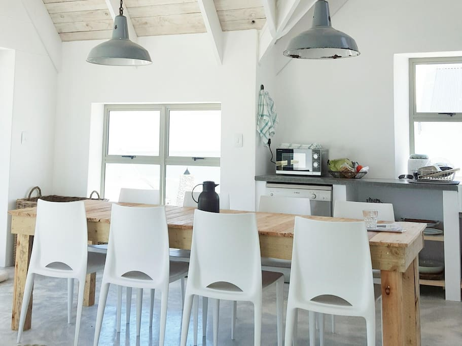 The dining area. Kitchen on the right, outdoor porch and braai (BBQ) area (panoramic views) to the left