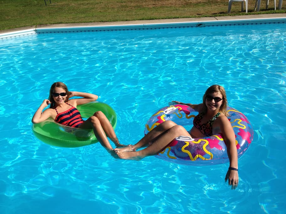 Outdoor swimming pool in the summertime.