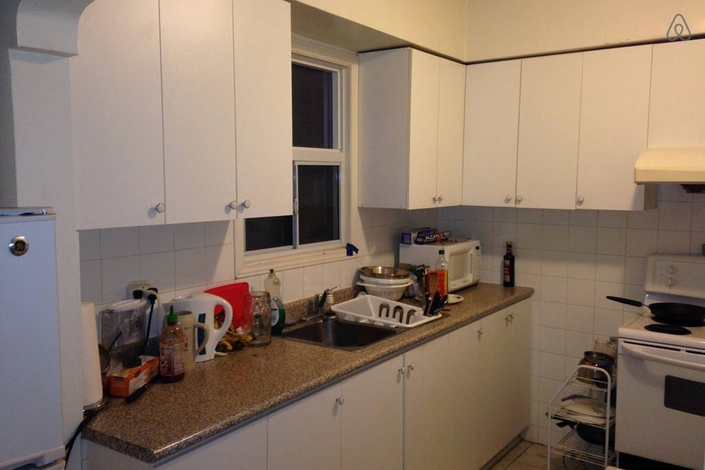 Kitchen includes a microwave, plenty of fridge/freezer/cabinet space, as well as an electric kettle.