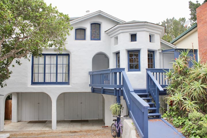 Cream painted home with navy trim, in a lighthouse castle design.  Large covered patio area for hosting.