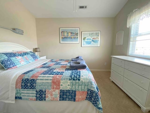 Fourth bedroom located on upper floor features a queen bed