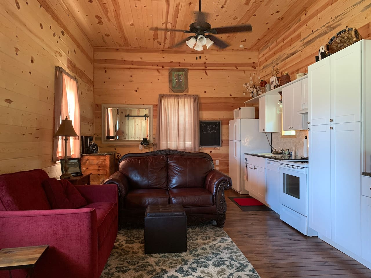 Welcome Home! The Tiny House is cozy and comfortable. One private bedroom, and one common space can accommodate up to 5 guests. 1 queen bed, 1 twin convertible bed, 1 blow up mattress. RV accommodations are on site for an additional charge.