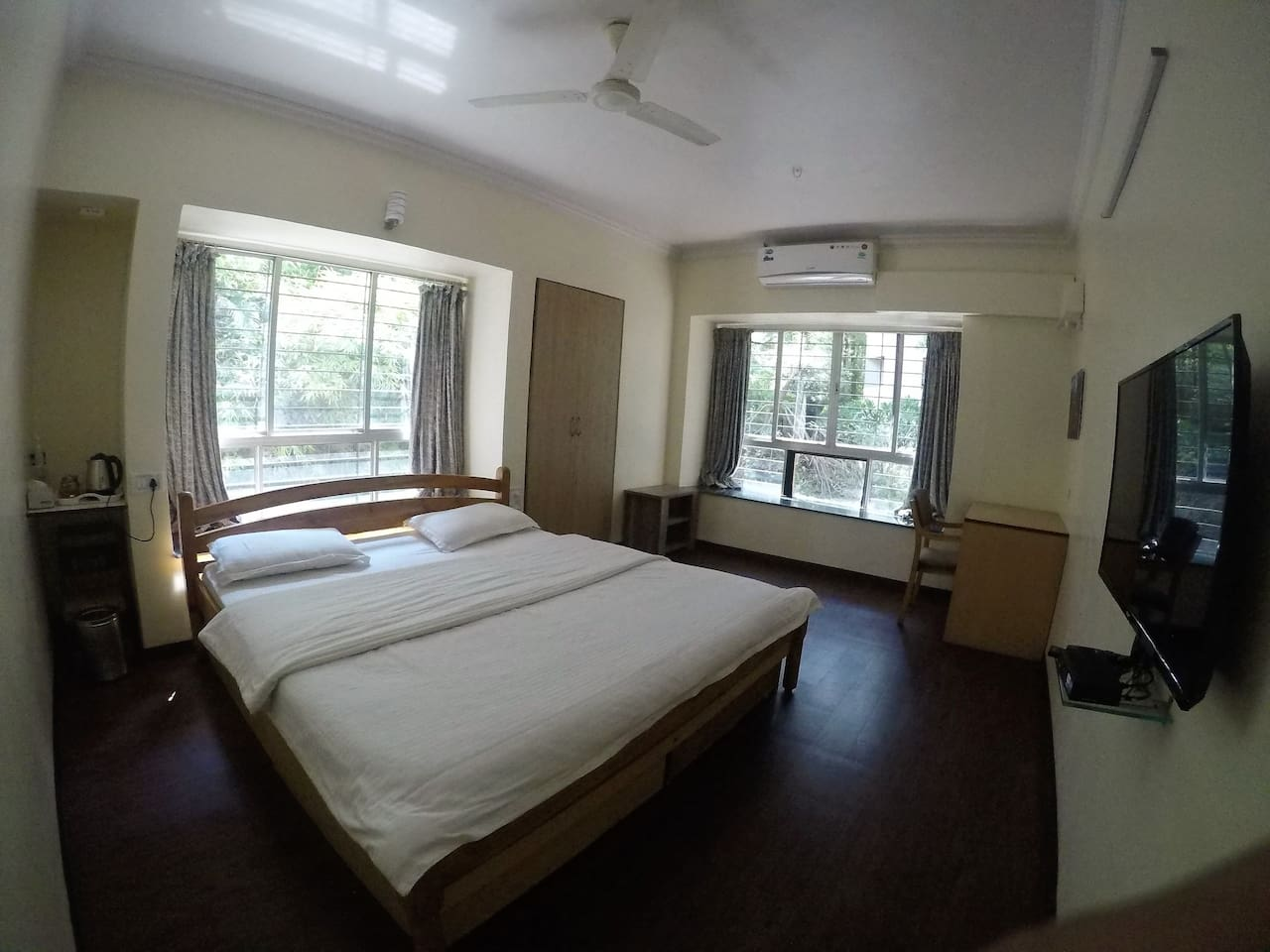 Bedroom with a king size bed, AC, TV, free WiFi, In room kettle, study table, wadrobe
