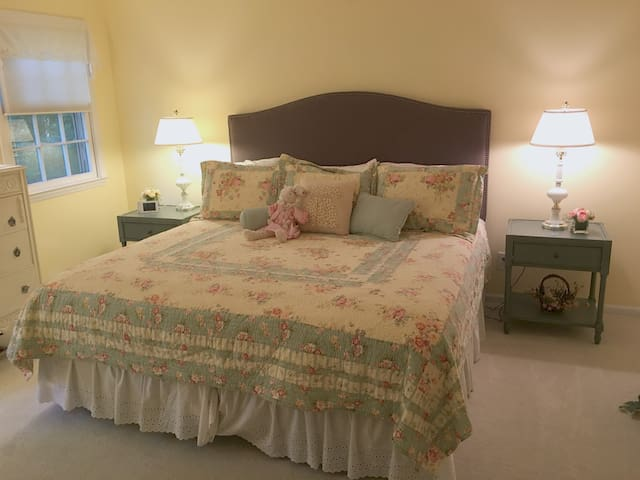 """""""Carolina On My Mind"""" bedroom: first floor with view to the private back yard. New firm king mattress (2017)."""
