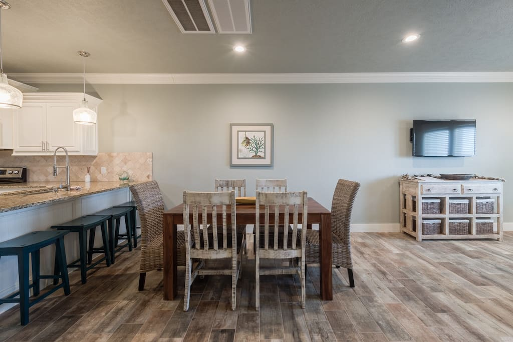 Large kitchen opens to the dining room with eat up bar and table with seating for 6