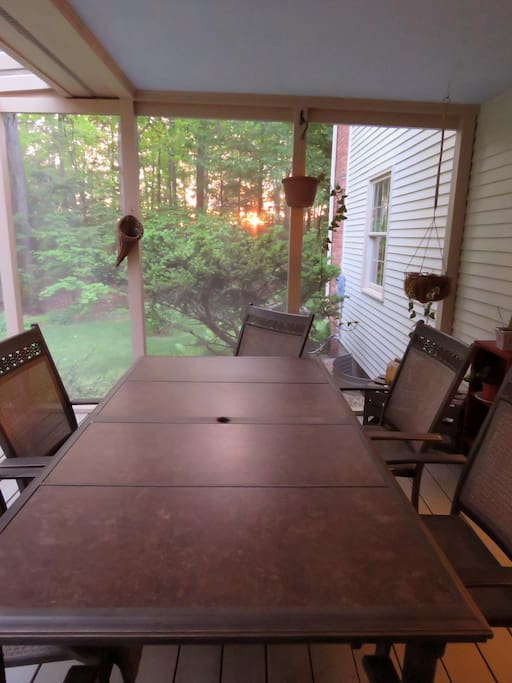 The screened in porch is a great place to eat dinner and enjoy the sunset