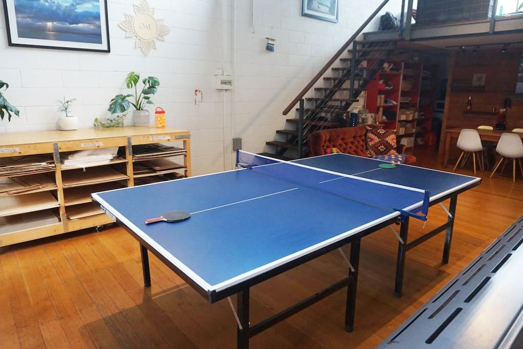 Downstairs studio with ping pong table.