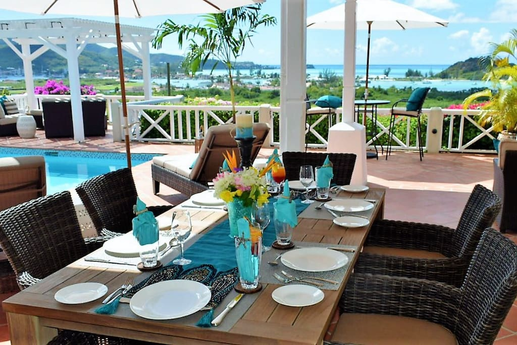 Indoor/outdoor living at AntiguaBella. Enjoy a meal overlooking the pool and Caribbean Sea.  AntiguaBella.